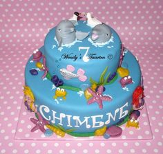 Dolphin Cake. I thought that it was time I showd some of my cakes. It has been a while.This is one I really liked. :D