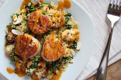 Seared Scallops over Roasted Cauliflower Spinach Couscous with a Curry Emulsion