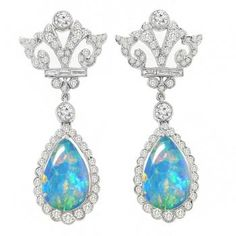 Art Deco Style 5.89ct Cabochon Pear Shape Opal 2.41ct Round & Baguette Diamond 18k White Gold Earrings - See more at: http://www.newyorkestatejewelry.com/earrings/antique--style--5.89ct-opal---2.41ct-diamond-earrings-/25105/5/item#sthash.fxbaU35V.dpuf