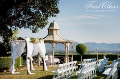 Ceremony - Topiaries, Beaumont House - Styling by First Class Weddings & Events. Brisbane Wedding Decorators.