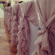 Stunning dusky pink ruffle hoods finished off with diamante brooches.