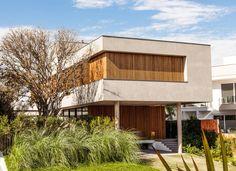Residência Premiê : Casas por MarchettiBonetti+