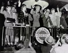 Judy Garland, Fred Astaire, Greer Garson, Betty Hutton, Mickey Rooney, Kay Kiser, Lucille Ball and Harpo Marx at a stop for the Hollywood Bond Cavalcade