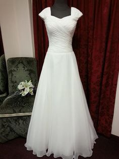 Totally Modest - Jeanette - Flowing Chiffon dress with ruched top, sweetheart neckline, cap sleeve and flowing skirt. Zipper back with buttons and chapel train. THIS WILL BE MY WEDDING DRESS Modest Wedding Dresses, Bridesmaid Dresses, Prom Dresses, Bridal Gowns, Wedding Gowns, Lds, Wedding Attire, Dream Dress, Chiffon Dress