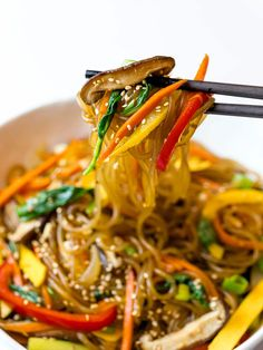 A simple, easy recipe for Japchae, also known as Korean glass noodles with stir fried vegetables. It's made with sweet potato starch noodles, colorful vegetables and tossed in a savory sauce! #japchae #Koreannoodles #glassnoodles #drivemehungry | drivemehungry.com Colorful Vegetables, Fried Vegetables, Japchae Noodles, Korean Red Pepper Flakes, Korean Glass Noodles, Easy Korean Recipes, Vegetarian Protein, Korean Dishes, Tossed