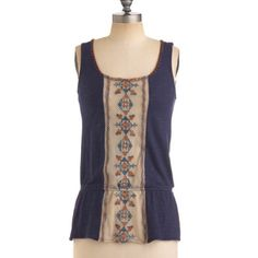 Modcloth Weaving The City Top Adorable, trendy top with decorative stitching, geometric/Aztec/tribal patterns, small side slits, and a stretchy band to define the waist. Awesome open back with crisscross weave. Seriously, the back is my favorite. Worn once - once again, Washington weather frustrates my attempts to wear cute clothes. ModCloth Tops Tank Tops