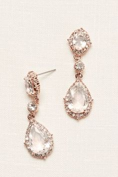 Give off an air of elegance with these rose gold filigree designed drop earrings with precious crystals!  Filigree design rose gold drop earring adorned with crystals.  Imported