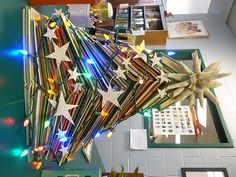 Library Christmas Tree.  Discarded books, card garland, book page star.  The kids love it!