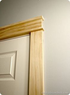 DIY craftsman door trim. I put it together using wood glue and the nail gun. It's made up of a 1 by 2 on top, a piece of the 1 by 4 in the middle and a piece of lattice (1/4 by 2) on the bottom. I just nailed that whole piece up when I was done: