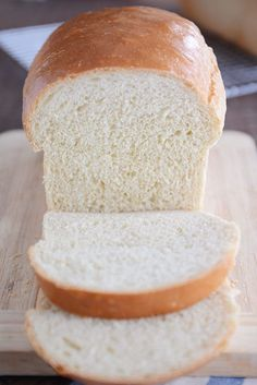 This is the best white sandwich bread ever! It is surprisingly easy to make and is perfect for sandwiches and toast (French toast, too!)! #whitebread #homemadebread #thebestwhitebread #breadfromscratch #melskitchencafe