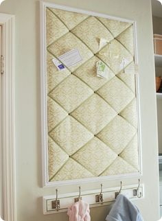 Fabric-covered memo board to organize school papers - hang by back door.
