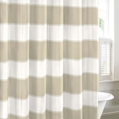 A taupe and white striped pattern makes this neutral shower curtain ideal for a variety of bathroom decor motifs. Crafted of machine washable cotton, this Guardhouse curtain by Nautica will bring instant style to your bathroom.