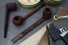 For classic English forms finished in some of the craggiest sandblasts around, look to Michael Parks. He's got three fresh pieces up today: a long-shanked Canadian and Prince, and a trim Bing-style Cutty. Plus fresh pipes from Michail Kyriazanos and. Tobacco Pipe Smoking, Cigar Smoking, Smoking Pipes, Tobacco Pipes, Wooden Pipe, Pipes And Cigars, Slow Burn, Best Husband, Wood Design