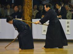 The next set of demonstrations is the jodo section. Here, the mother and daughter team of Eto Eiko and Eto Tomoko demonstrate Shintō Muso-ryū jōjutsu. By any standard, Eto Eiko is one of the world's most accomplished martial artists, holding the rank of 7-dan or higher in each of judo, kendo, jodo, iaido, aikido, and kyudo.
