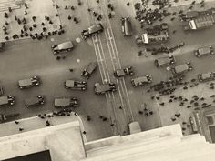 """A view of the intersection at 5th Avenue and 42nd Street. Lol grid lock with horse drawn carriages, cars and pedestrians""""1918."""""""