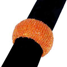 Orange Beaded Round Napkin Rings, Set of 6, Variety of orange shades of napkin rings, coasters, napkins, table overlays, wine bottle covers, and garland at alwayselegant.com