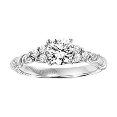 I love the setting  of the main diamond! I also really like the carved band!    ArtCarved - 31-V105DRW