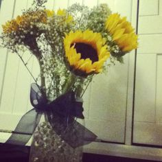 I made these centerpieces for Kristen's wedding reception. Easy, fun, and affordable ....  Adorable Sunflower Centerpiece