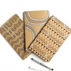 Grab some of those cool Kraft Moleskines, doodle all over them, and you'll have a great personalized place to stash all your thoughts.