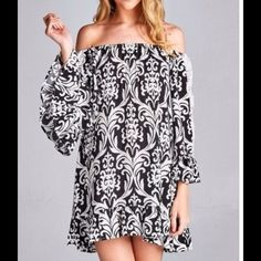 NWOT Beautiful black/white print tunic NWOT Beautiful black/white print tunic dress featuring on-off shoulders with lace detail on sleeves. Ruffled bottom hem and sleeve. Lightweight.  100%Cotton.  PLEASE DO NOT PURCHASE THIS LISTING..PLEASE REQUEST FOR SEPARATE LISTING TO BE MADE.  THANK YOU❤️ Dresses