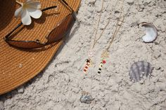 Long nautical necklaces by Shlomit Ofir. Available at www.pinwheeljewels.com