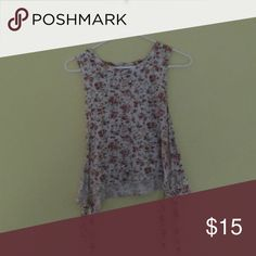 Flower sleeveless top This sleeveless crop top has two ties on the sides. Forever 21 Tops Crop Tops