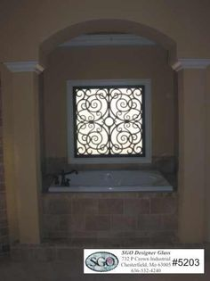 faux iron on bath window...nice faucet too