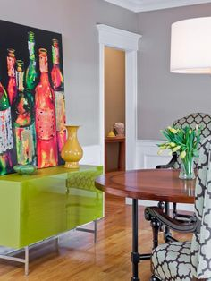 See a flashy dining room with a lime green lacquered sideboard and chairs upholstered in a Moroccan print fabric on HGTV.