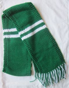Show your spirit with a knit scarf in New York Jets colors! Keep warm during those cold football games.    Scarf measures 60 inches long not