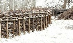 a basket-woven WATTLE Fence...I make my own using worn out drumsticks and willow branches...keeps the rabbits out of the lettuce ;)