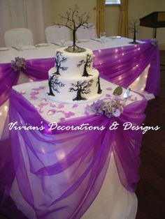 beautiful! using tulle as a swag around the cake table and head table... or any small tables.