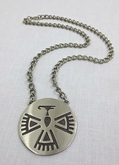 This vintage sterling silver Hopi overlay pendant necklace has a wonderful thunderbird pattern!