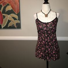 "Zipper-front tank top So cute and feminine in black with pink floral pattern. This cutie has a zipper running the entire length of the front to give it some edge. Black back-tie sash. Adjustable straps. 24"" long, 24"" across the chest. 100% rayon. Love Culture Tops"