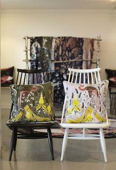 Ilmari Tapiovaara by Artek Mademoiselle lounge chairs display KH's Crane pillows in linen.