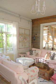 Wood covered wall, old wooden window and old wooden create coffee table. Rustic Chic.
