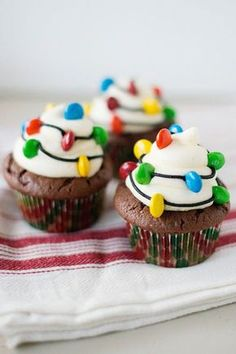 Light up your cupcakes with colorful M&M's and black frosting. Serve at your kid's next bake sale.
