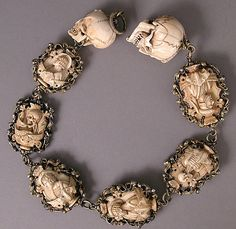 """Nothing says """"Merry Christmas"""" like chain of skulls. It's a very jolly rosary. Germany 1500-1525. Iron, silver and gilded mounts."""