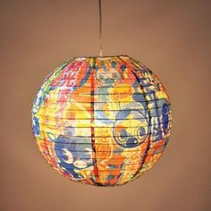 """Good and Plenty Paper Lantern This lamp is louder than 26 Anime films playing at the same time - but without the noise. TRUE eye candy for the soul. Design by 64 Colors. Includes spring-action expander. Cord Kit NOT included. 13 3/4"""" diameter. 1 new from $9.95"""