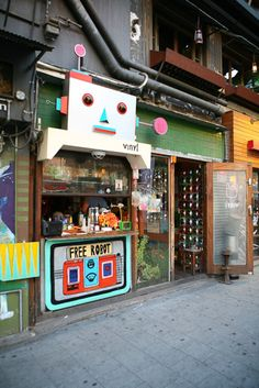 Vinyl Bar in Hongdae, famous for their little robot mascot and to-go drinks in plastic bags.