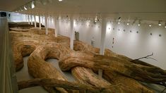 Artist Henrique Oliveira Constructs a Cavernous Network of Repurposed Wood Tunnels at MAC USP wood installation architecture Installation Architecture, Artistic Installation, Colossal Art, Repurposed Wood, Recycled Wood, Museum Of Contemporary Art, Modern Art, Land Art, Summer Art