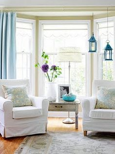 matching chairs in front of bay window instead of couch might feel more open