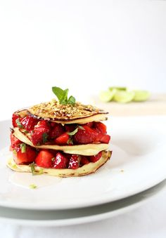 Pancake with ricotta and salad of strawberries, pistachios and honey