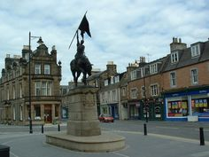 Hawick Town Square  Hawick is a mill town in Scotland about 10 miles west of Jedburgh.   Hawick is pronounced more like 'hoik' by locals.  A great place for shopping for woollen goods.