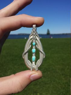 handmade in the USA Turquoise and silver wire wrapped pendant