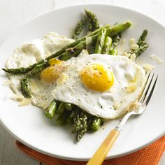 Such an interesting dinner idea:  Gale Gand's Grilled Asparagus with Fried Eggs & Parmesan
