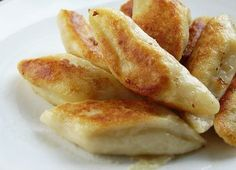 Kopytka ~  a potato dumpling, boiled, then sauteed in butter or with bacon and topped with, what else? Sour cream...
