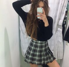 Plaid skirts give a school girl vibe. Pair with a cropped shirt so as not to look too formal.