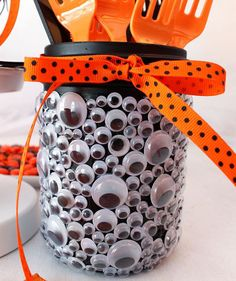 For this decoration you will need an ordinary jar, decorations, such as eyes, orange ribbons and black. Orange and black are the colors of this holiday, so decorate your house and garden in these shades.