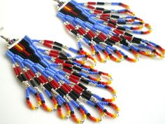 Native American Inspired Looped Fringe Bugle Bead Earrings.  These earrings are hand stitched by me bead by bead, one-bead-at-a-time. They are created in a brick or Cheyenne stitch style. They are mad