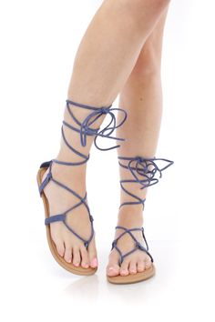 These sexy and stylish sandals are a must have this season! The features include a denim fabric upper with a wrap around string tie design, thong post, smooth lining, and cushioned footbed.